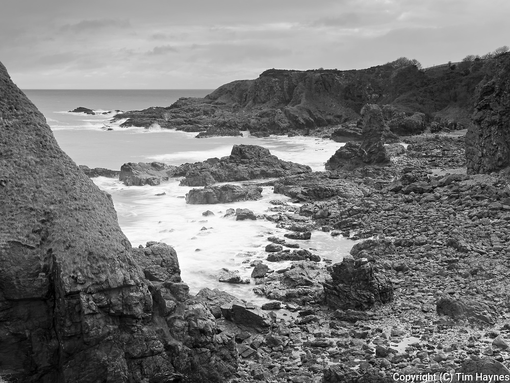 Rocky coastline and small sea-stacks at Muchalls, Aberdeenshire