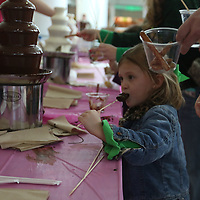 Libby Ezell | BUY at PHOTOS.DJOURNAL.COM<br /> Lilly Gurley, 4, takes a bite of her chocolate covered marshmellows at Saturday's NEWMS Chocolate Festival