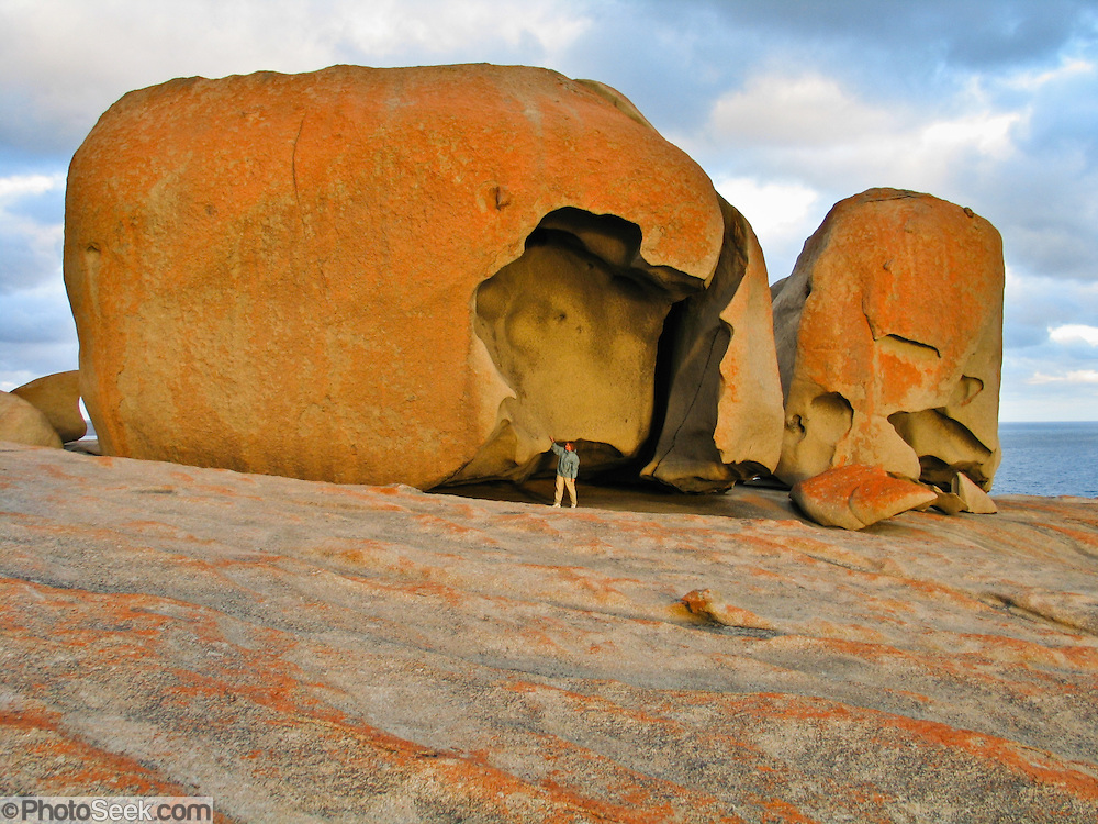 The Remarkable Rocks form fantastic shapes in Flinders Chase National Park, Kangaroo Island, South Australia. The Remarkable Rocks began as magma injected into a sedimentary rock layer and crystallized into a single granite monolith a few kilometers below the earths surface. Subsurface weathering cracked the granite along joint planes and created corestones. Erosion peeled away the surface and revealed the corestones, which were sculpted asymmetrically by the affects of rain and prevailing southerly winds.