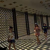 Tourist walk to visit National Monument, Kuala Lumpur, Malaysia.