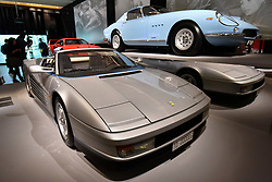 "© Licensed to London News Pictures. 14/11/2017. London, UK.  (L to R) A Ferrari Testarossa Spyder, 1986, commissioned by Gianni Agnelli to commemorate his 20th anniversary as Chairman of Fiat, and a Ferrari 275 GTB/4, 1967.  Preview of ""Ferrari: Under the Skin"", an exhibition at the Design Museum to mark the 70th anniversary of Ferrari.  Over GBP140m worth of Ferraris are on display from private collections including Michael Schumacher's 2000 F1 winning car.  The exhibition runs 15 November to 15 April 2018.  Photo credit: Stephen Chung/LNP"