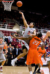 December 16, 2009; Stanford, CA, USA;  Stanford Cardinal guard/forward Landry Fields (2) shoots over Oklahoma State Cowboys guard James Anderson (23) during the first half at Maples Pavilion.  Oklahoma State defeated Stanford 71-70.
