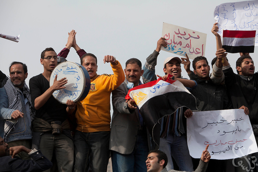 "Egyptians beat drums and chant anti-government slogans during a  ""million man march"" demonstration February 01, 2011 in Central Cairo's Tahrir, or ""Liberation"" square. The march capped a week of protests that are threatening to bring down the nearly 30 year old regime of Hosni Mubarak."