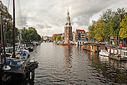Montelbaanstoren Tower and Oudeschans canal in Amsterdam.