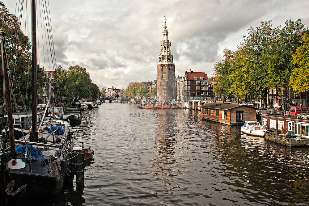 Montelbaanstoren Tower and Oudeschans canal in Amsterdam.
