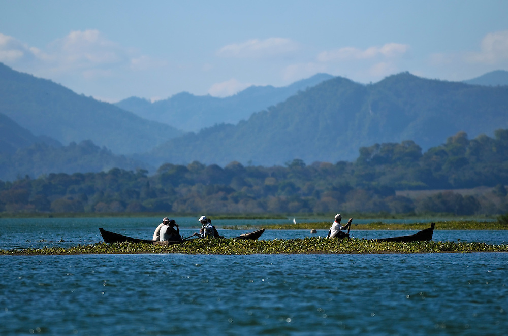 Local men fish in Lake Yojoa in northwestern Honduras.  They say they have found more fish species in their catches since Regal Springs began aqua farming tilapia in the lake 10 years ago.