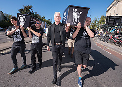 """© Licensed to London News Pictures. 20/09/2019. Bristol, UK. Wildlife filmmakers with """"Film Strike for Climate"""" take part in the Global Climate Strike on 20 September 2019. Bristol is an international centre for wildlife filmmaking, and Film Strike for Climate is a movement within the film industry to mobilise cast, crew and industry member to strike on September 20th to demand radical and immediate international climate action. The Bristol event, with Bristol Youth Strike 4 Climate, is part of a UK wide and international day of protest as students and school pupils and adult workers across the world miss classes and strike to protest a lack of governments' action to combat the climate crisis, ahead of the 2019 Climate Action Summit in New York on 23 September with plans to address the global climate emergency. The international school strike for climate movement was started by Swedish student Greta Thunberg. Photo credit: Simon Chapman/LNP."""