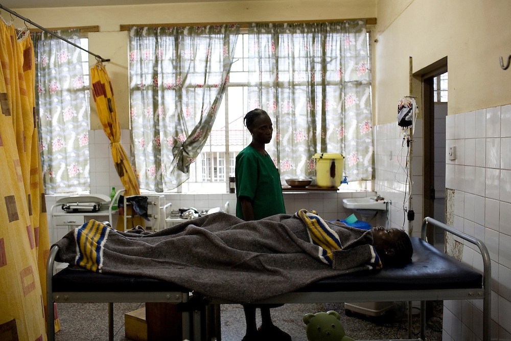 Nursing aid Isatu Bangura watches Mommy after she died, one by one all the nurses leave the body. Mommy delivered and died from postpartum bleeding at the PCMH (Princess Christian Memorial Hospital), Freetown, Sierra Leone.