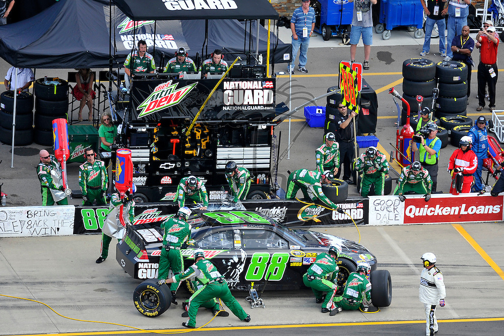 Brooklyn, MI - JUN 17, 2012: Dale Earnhardt, Jr. (88) makes a pit stop during race action for the Quicken Loans 400 race at the Michigan International Speedway in Brooklyn, MI.
