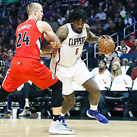 12 December 2016: LA Clippers center DeAndre Jordan (6) drives past Portland Trail Blazers center Mason Plumlee (24) during the LA Clippers 121-120 victory over the Portland Trail Blazers, at the Staples Center, Los Angeles, California, USA.