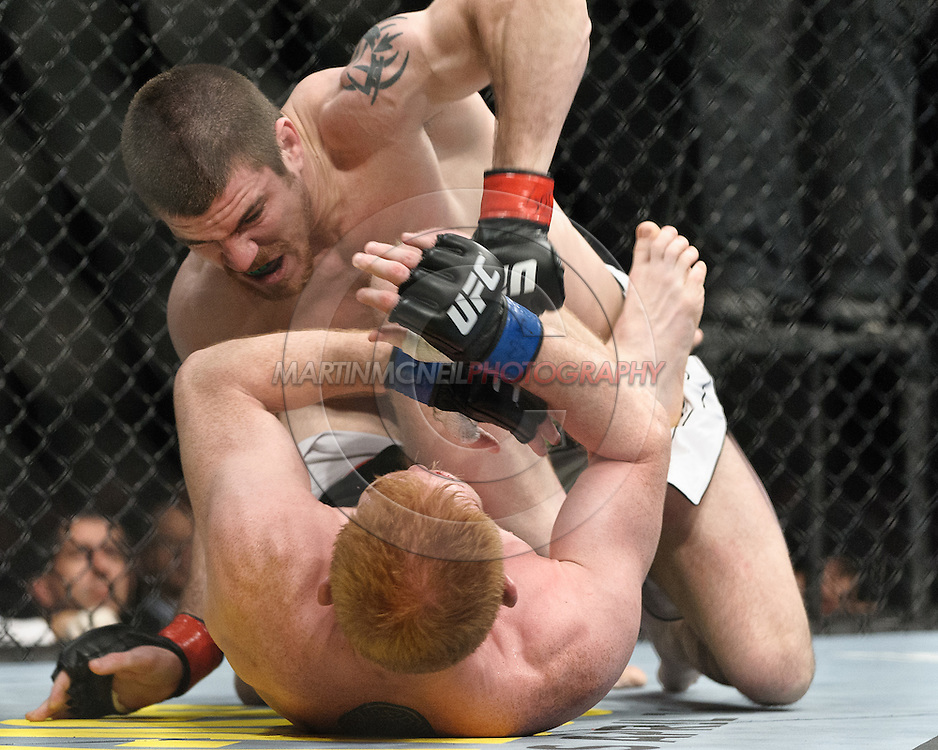 "NEWARK, NEW JERSEY, MARCH 27, 2010: Jim Miller (top) and Mark Bocek are pictured during their bout at ""UFC 111: St. Pierre vs. Hardy"" in the Prudential Center, New Jersey on March 27, 2010"