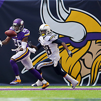 MINNEAPOLIS, MN - AUGUST 28: Mackensie Alexander #20 of the Minnesota Vikings bobbles an interception while DeAndre Reaves #88 of the San Diego Chargers in the fourth quarter against the San Diego Chargers at US Bank stadium on August 28, 2016 in Minneapolis, Minnesota. (Photo by Adam Bettcher/Getty Images) *** Local Caption *** Mackenzie Alexander; DeAndre Reaves