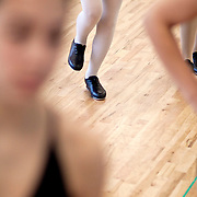 Oct. 5, 2010. Miami, FL. Nicole Sharf practices her flaps across the floor with her classmates in the advanced/intermediate tap class Tuesday afternoon, Oct. 5, at the Coconut Grove Ballet Dance Center located in the Coconut Grove area of Miami, FL. The hour-long class, which is taught by Carla Noriega, is offered once a week and consists of about seven students. Photo by Brittney Bomnin