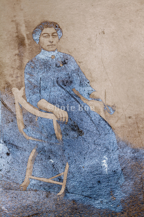 emulsion oxidizing studio photo portrait of a adult woman sitting in a chair