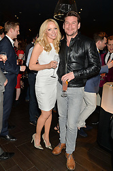 LIZ McCLARNON and GARY COCKERILL at a party to celebrate the publication of Behind The Mask by Emma Sayle held at The Playboy Club, 14 Old Park Lane, London on 23rd April 2014.