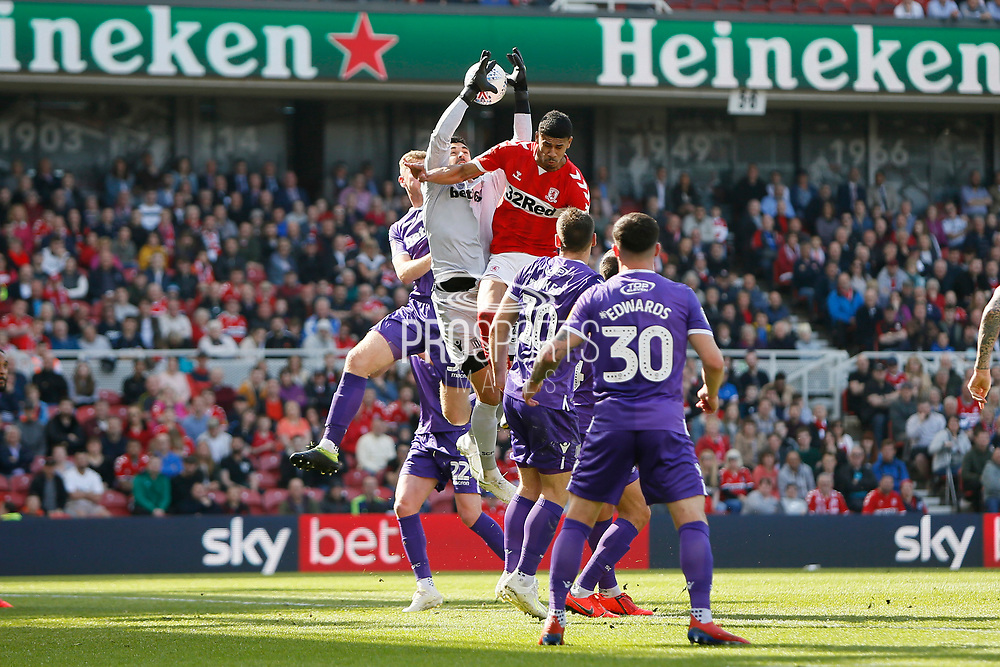 Stoke City goalkeeper Adam Federici (32) spills a cross under pressure from Middlesbrough forward Ashley Fletcher (18)  during the EFL Sky Bet Championship match between Middlesbrough and Stoke City at the Riverside Stadium, Middlesbrough, England on 19 April 2019.