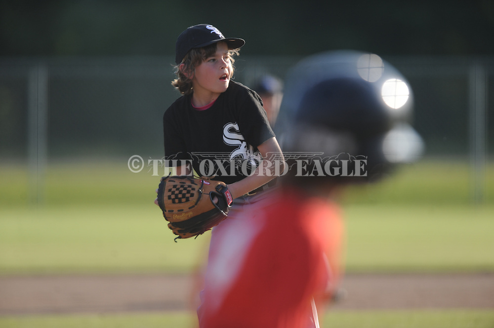 The White Sox Stratton Ponder throws to first for an out against the Cardinals in Oxford Park Commission baseball action at FNC Park in Oxford, Miss. on Tuesday 20, 2014.