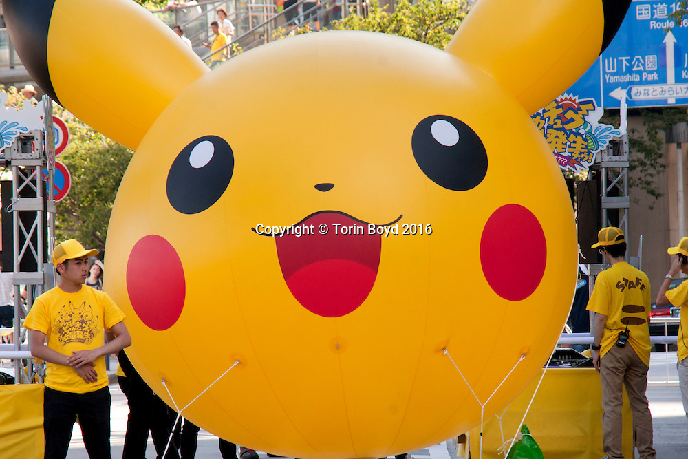 August 7, 2016, Yokohama, Japan: This is a parade of hundreds of dancing Pikachu mascots, part of Pikachu Outbreak!, a weeklong extravaganza dedicated to Pikachu, the lovable Pokemon character held in Yokohama from August 7 -14, 2016. This annual summer event started in 2014 involves hundreds of Pikachu mascots and huge inflatables making appearances at venues throughout the city's waterfront district known as Minato Mirai. In addition to this parade, other events include a large gathering of Pikachu splashing themselves and fans, a hula dance event, a Pikachu fishing pool, stage performances, Pikachu merchandise for sale and Pikachu photo studios. (Torin Boyd/Polaris).