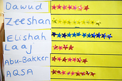 Notice board showing stars received for good work at the Nottingham Islamia school,
