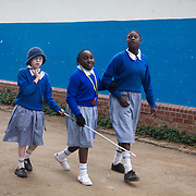 The Stars Foundation visiting the Kenya Society for the Blind.The Kenya Society for the Blind is a long standing charity which works to make blind people able to function in the community as a whole. They support children in schools and supply them with Braille writers, specialist teachers,glasses for visually impaired,counseling and other much needed tools. .Three blind and visullay impaired girls at Kalimani Primary School, a regular school in which the girls attend regular class. The girls are friends and waiting to go on a tour to a local college to give a talk and read poems about their lives.