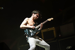 "© Licensed to London News Pictures. 03/04/2013. London, UK.  Simon Neil of Biffy Clyro performing live at O2 Arena. Biffy Clyro are a Scottish rock band comprising Simon Neil (guitar, lead vocals), James Johnston (bass, vocals) and Ben Johnston (drums, vocals).   This year they released their sixth studio album, ""Opposites"".   Photo credit : Richard Isaac/LNP"