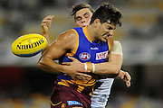 Sam Mayes of Brisbane is tackled by Zac Williams of Greater Western Sydney during the Round 21 AFL match between the Brisbane Lions and the Greater Western Sydney Giants at the Gabba in Brisbane, Saturday, Aug. 17, 2013. (AAP Image/Matt Roberts) NO ARCHIVING, EDITORIAL USE ONLY