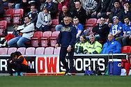 Leeds United Manager Neil Redfearn looks on. Skybet football league championship match , Wigan Athletic v Leeds Utd at the DW Stadium in Wigan, Lancs on Saturday 7th March 2014.<br /> pic by Chris Stading, Andrew Orchard sports photography.