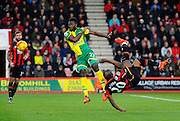 AFC Bournemouth forward Benik Afobe attempts an overhead kick while under pressure from Norwich City midfielder Alexander Tettey during the Barclays Premier League match between Bournemouth and Norwich City at the Goldsands Stadium, Bournemouth, England on 16 January 2016. Photo by Graham Hunt.