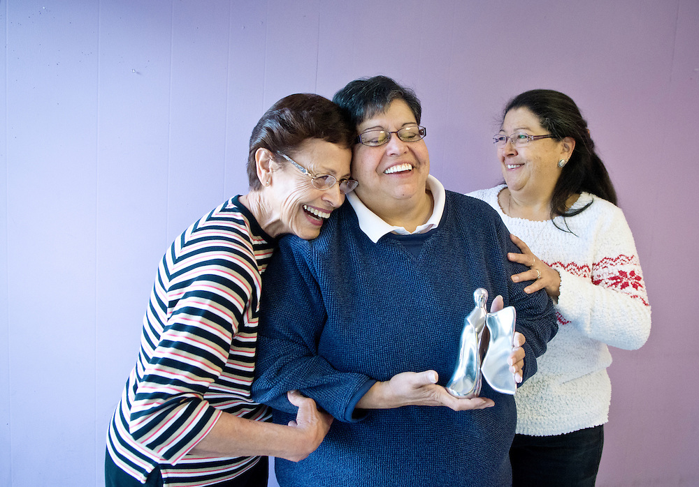 mkb122016/metro/Marla Brose122016<br /> Kathy Trujillo, center, program director for Connections, an adult day-hab for special needs adults, is one of the recipients of the Angels Among Us award. She celebrates with her sister Lydia Paiz, left, and niece Teri Salazar, right.<br />  (Marla Brose/Albuquerque Journal)