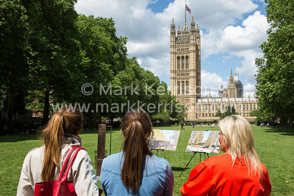 London, UK. 6 June, 2019. Lucy Tilley (r), Associate Principal of Adjaye Associates architects, observes the display of bronze and limestone for the UK Holocaust Memorial and Learning Centre in Victoria Tower Gardens beside Parliament for selection by Lord Pickles and Ed Balls, co-chairs of the UK Holocaust Memorial Fund. The Prime Minister recently led cross-party support for the new memorial.