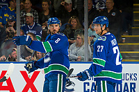 KELOWNA, BC - SEPTEMBER 29: Ben Hutton #27 stands behind Christopher Tanev #8 of the Vancouver Canucks as he points down the ice against the Arizona Coyotes at Prospera Place on September 29, 2018 in Kelowna, Canada. (Photo by Marissa Baecker/NHLI via Getty Images)  *** Local Caption *** Ben Hutton;Christopher Tanev