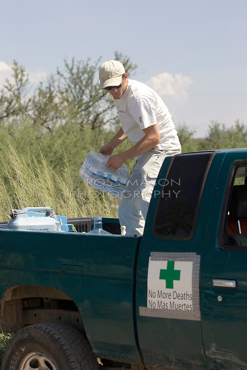 Walt Staton unloads water at the No More Deaths camp in southern Arizona.