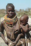 Africa. Northern Kenya, Longalani. Mixed tribal settlement on the shores of Lake Turkana. Turkana woman and child..CD0011.