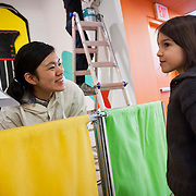 "March 10, 2012 - New York, NY : Misaki Kawai, left, stops to chat with siz-year-old Luca Adams during the installation of Kawai's ""Love from Mt. Pom Pom,"" at the Children's Museum of the Arts in the south village on March 10. CREDIT: Karsten Moran for The New York Times"