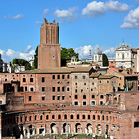 Trajan's Market at Forum of Trajan in Rome, Italy<br /> Adjacent to the Forum of Trajan is Trajan's Market. This multi-story complex built into Quirinal Hill housed about 150 stores and offices plus warehouses. Think of it as a 1,900 year old shopping mall with commercial space. The main hall inside is supported by intersecting concrete barrel vaults (called groin vaults). This was an extremely innovative design for the early 2nd century AD. Apollodorus of Damascus was the genus architect. He was the same man who created Trajan's Forum and the Pantheon. Unfortunately, his illustrious career ended abruptly when Emperor Trajan died in 117. After the new emperor Hadrian was offended by a remark of Apollodorus, the architect was banished. Some historians believed he was also executed.