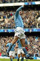 Photo. Aidan Ellis.<br /> Manchester City v Manchester United.<br /> FA Barclaycard Premiership.<br /> 14/03/2004.<br /> City's Jon Macken celebrates his goal and City's second
