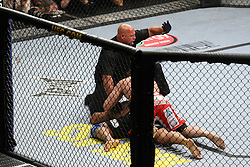 Mar 27, 2010; Newark, NJ, USA; Frank Mir (black trunks) and Shane Carwin (white/red trunks) fight for the interim UFC Heavyweight Championship at UFC 111 at the Prudential Center in Newark, NJ.  Carwin won via first round KO.