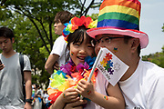 A young kid and her father take part in the Tokyo Rainbow Pride parade in Tokyo. Thousands of lesbians, gays, bisexuals, transgenders (LGBT) and their supporters participated in the parade on Sunday to celebrate LGBT lifestyle and denounce prejudice and discrimination against sexual minorities. Amnesty International Japan released a proposal Tuesday May 2, 2017 to the government on measures that the country must take to tackle discrimination against LGBT people: hiding one's sexual orientation or gender identity is still common, due to a fear of losing one's job or facing discrimination, both in the public and the private sector. On health, they asked the government to remove gender identity from the classification of mental diseases, to abolish inappropriate requirements for obtaining legal gender recognition, to educate medical experts, and to set certain health treatments required by transgender people to be covered by the national health insurance and public health systems. 07/05/2017-Tokyo, JAPAN