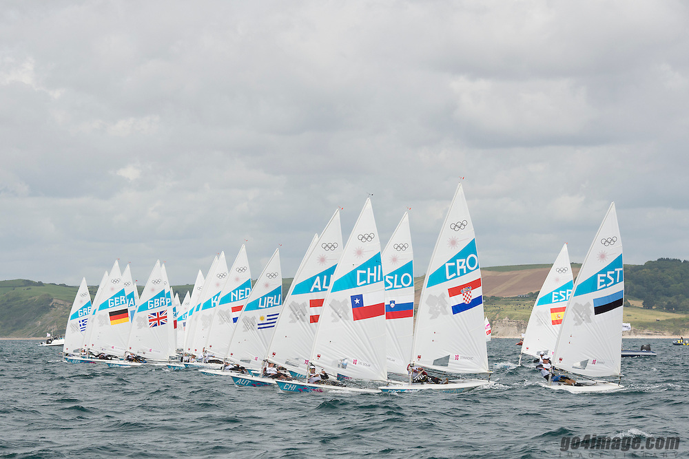 2012 Olympic Games London / Weymouth<br /> Racing day 1 Laser<br /> Laser Standard Fleet after the start