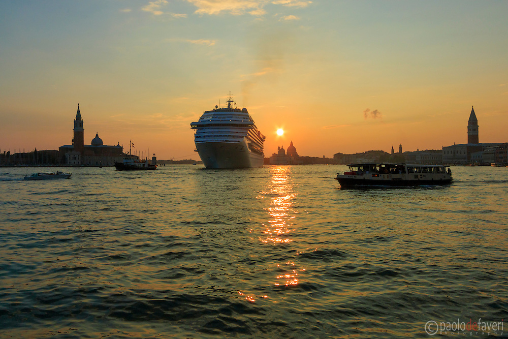 A taxi boat, a vaporetto, a tugboat and a big cruiser/liner all together in the San Marco Basin. Taken at sunset from Riva degli Schiavoni.
