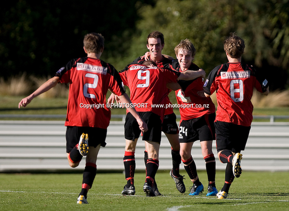 Canterbury United player Sam Miles is mobbed by his team mates, Anthony Jones (2), Luke Dennison (9) and Jacob Allen (8) following Canterbury's 6th goal. Lion Foundation Youth League Final, Canterbury United v Waitakere United, English Park, Christchurch, Sunday 11 April 2010. Photo : Joseph Johnson/PHOTOSPORT