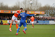 AFC Wimbledon striker Joe Pigott (39) having his shirt pulled and being fouled during the EFL Sky Bet League 1 match between AFC Wimbledon and Blackpool at the Cherry Red Records Stadium, Kingston, England on 22 February 2020.