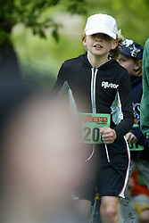 """(Kingston, Ontario---16/05/09) """"Rhiannon Murphy running in the kids race at the 2009 Salomon 5 Peaks Trail Running series Race held in Kingston, Ontario as part of the Eastern Ontario/Quebec division. """"  Copyright photograph Sean Burges / Mundo Sport Images, 2009. www.mundosportimages.com / www.msievents.com."""