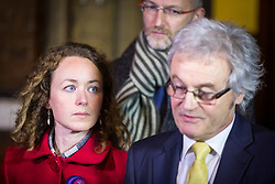 © Licensed to London News Pictures. 22/11/2017. Wakefield, UK. Kerry Maguire (daughter of Ann Maguire) watches her father Don Maguire (husband of Ann Maguire speak to media after a jury reached a verdict of unlawful killing at Wakefield Coroners Court today. Mrs Maguire, a 61 year old Spanish teacher, was stabbed to death by Will Cornick at Corpus Christi Catholic College in Leeds in April 2014. The school pupil, who was 15 at the time, admitted murdering Mrs Maguire and was given a life sentence later that year. Since then, some of Mrs Maguire's family have campaigned for further investigation into her death as they believe more could have been done to prevent the tragedy. Photo credit: Andrew McCaren/LNP