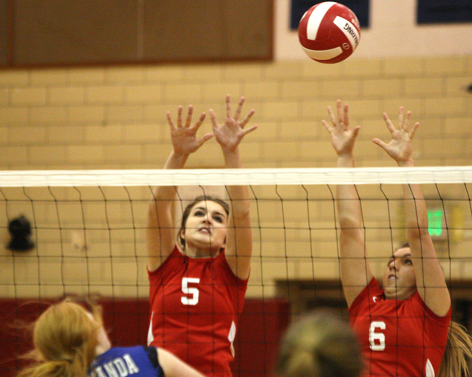 Southwestern's Brooke LaTour and Kayla Snyder go for a block aginst Gowanda during volleyball action 11-2-15 photo by Mark L Anderson