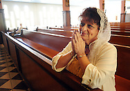 POPESHRINE20P<br /> Luanne Hartnett, of Springtown, Pennsylvania prays before the start of 11:30am mass at the National Shrine of Our Lady of Czestochowa Monday September 14, 2015 in Doylestown, Pennsylvania. Pope Francis will visit Philadelphia September 26 and 27th. (William Thomas Cain/For The Inquirer)