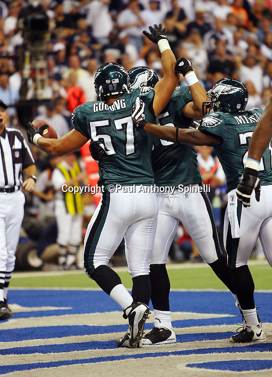 IRVING, TX - SEPTEMBER 15:  Linebacker Chris Gocong #57 of the Philadelphia Eagles celebrates with teammates after recovering a Dallas Cowboys fumble for a touchdown during the game at Texas Stadium on September 15, 2008 in Irving, Texas. The Cowboys defeated the Eagles 41-37. ©Paul Anthony Spinelli *** Local Caption *** Chris Gocong