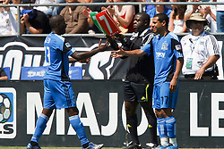 August 21, 2010; Santa Clara, CA, USA;  San Jose Earthquakes midfielder Geovanni Deiberson Maurico (right) enters the game for forward Cornell Glen (13) during the second half against the Los Angeles Galaxy at Buck Shaw Stadium. San Jose defeated Los Angeles 1-0.