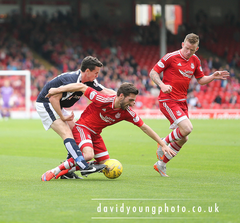 Dundee's Paul McGinn tackles Aberdeen&rsquo;s Graeme Shinnie- Aberdeen v Dundee at Pittodrie<br /> - Ladbrokes Premiership<br /> <br />  - &copy; David Young - www.davidyoungphoto.co.uk - email: davidyoungphoto@gmail.com