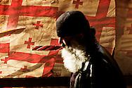 Tbilisi, Georgia - 25 marzo 2012. Un uomo passeggia nel centro di Tbilisi. Sullo sfondo la bandiera georgiana..Ph. Roberto Salomone Ag. Controluce.GEORGIA - A man walks in downtown Tbilisi on February 25, 2012. In the back groung the georgian flag.
